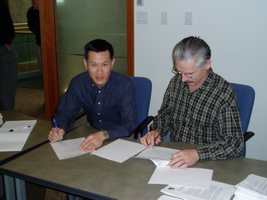Ray fung and tim pringle signing mou